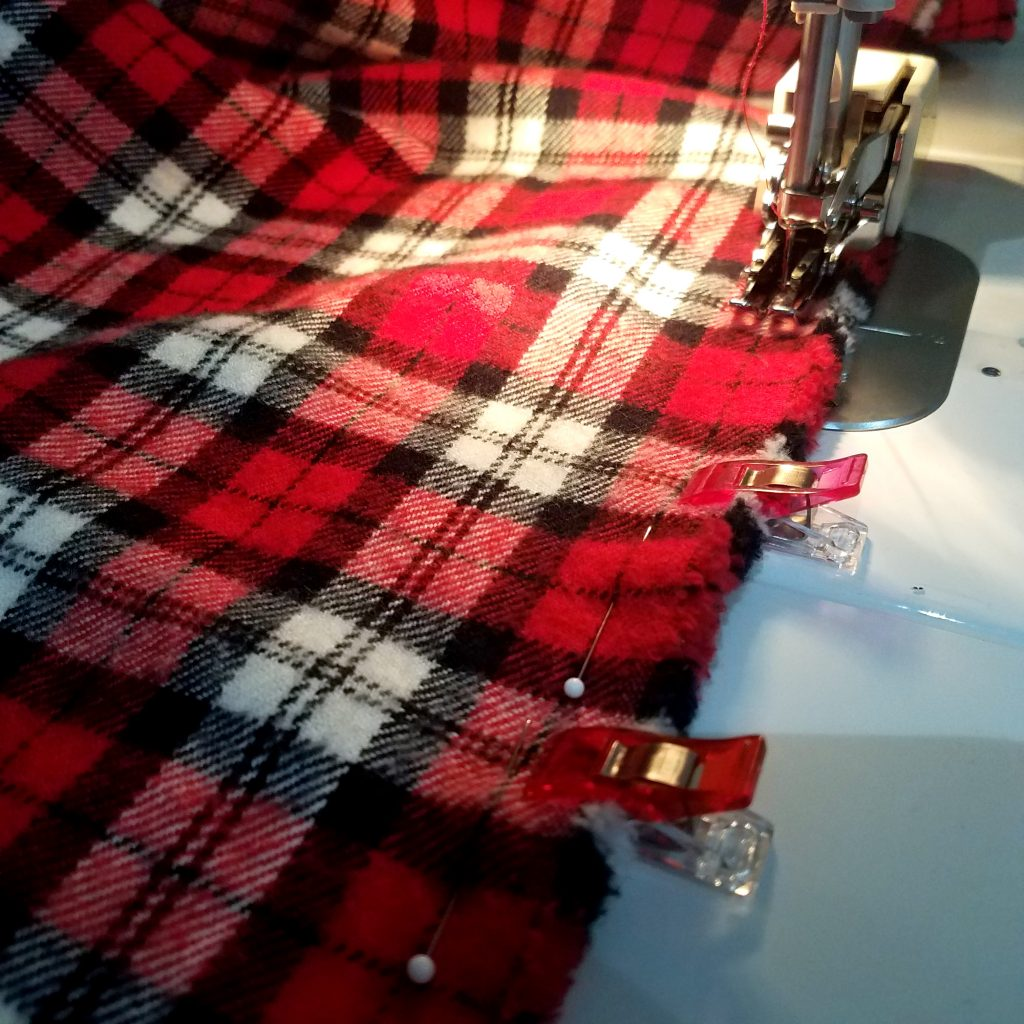Using pins and clips when piecing flannel.